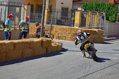 Burnt Motorcycle Tyre. A racer taking the bend during the Algueña motorcycle street race in Spain royalty free stock image