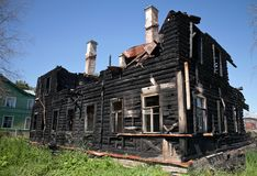 Burnt old wooden building Stock Images