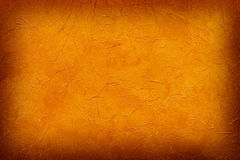 Burnt orange background wallpaper. Orange vignetted abstract texture for wallpaper or background Stock Photos