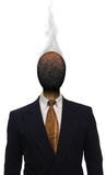 Burnt Out. Burnt matchhead emerging from the collar of a business suit where a man's head should be Stock Images