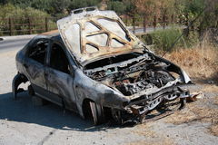 Burnt out car. Calabria, Italy Royalty Free Stock Image