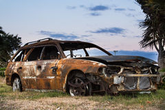 Burnt Out Car. Car that has been burn right out, even the tyres are burnt up Stock Photography