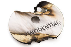 Burnt out confidential cd with clipping path. Burnt out confidential cd on white with clipping path Stock Images