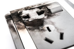 Burnt out electric socket close up on white background Royalty Free Stock Images