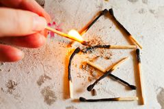 Burnt out family house after fire made of used matches - safety royalty free stock photo