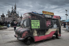 Burnt out ice cream van at Banksys Dismaland Bemusement Park. Royalty Free Stock Photos