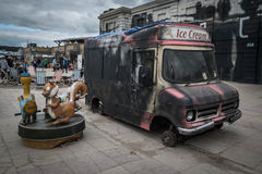 Burnt out ice cream van at Banksys Dismaland Bemusment Park. Royalty Free Stock Photos