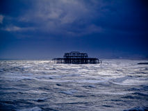 A burnt out pier in the sea Stock Photo