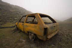 Burnt out and rusted car Stock Photo