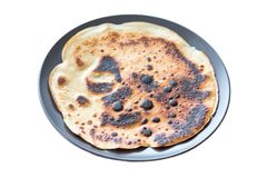 Burnt pancake presented on a plate, royalty free stock photos