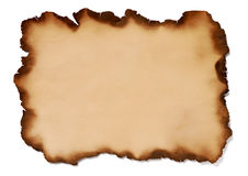 Burnt paper. With frayed edges on white background stock image