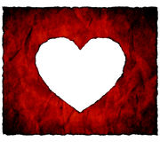 Burnt paper heart. On white background Stock Image