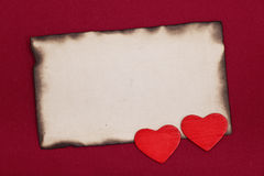 Burnt paper and hearts Royalty Free Stock Photos