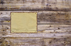 Burnt paper and weathered planks. Burnt obsolete paper tacked to a wooden rough planks with nails Stock Photos