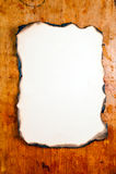 Burnt paper at wooden desk Stock Image