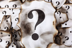 Burnt Question Marks Stock Photo