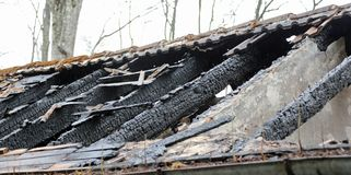 Burnt roof of a old house Stock Photos