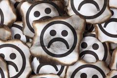 Burnt Sad Faces Stock Photography