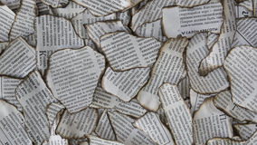Burnt scraps of newspaper for background Stock Images