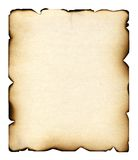 Burnt sheet. The burnt sheet of the old paper which burnt out under beams of the scorching sun and has turned yellow from time. The photo is isolated on a white Royalty Free Stock Photos