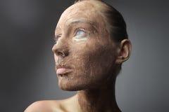 Burnt sienna visage Stock Photo