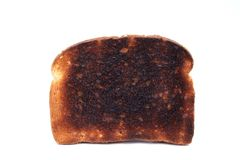 Burnt Toast. Piece of burnt toast on a white background Stock Images