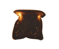 Burnt Toast. A piece of very burnt toast on white Stock Photography