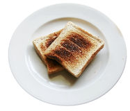 Burnt toast bread slice on dish ,isolated white backround Royalty Free Stock Image