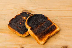 Burnt toast bread slices Stock Photography