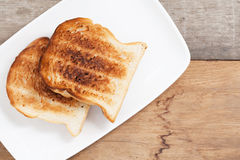 Burnt toast at breakfast. Stock Image