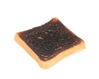 Burnt toast close up. Royalty Free Stock Photo