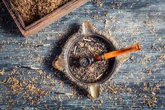 Burnt tobacco in an old wooden pipe Stock Images