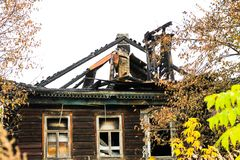Free Burnt Traditional Russian Wooden House Izba In Autumn Stock Images - 104044914