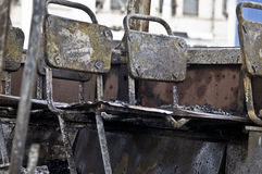 Burnt tram inside - burned seats are in a row Stock Photo