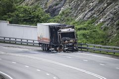 Burnt truck on the highway. The car after the fire Royalty Free Stock Image