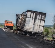 Burnt truck on the side of highway