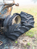 Burnt wheel of tractor Stock Images