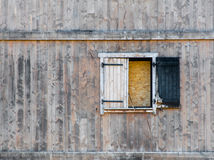 Burnt window shutter in dilapidated wooden building Royalty Free Stock Image
