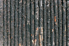 Burnt woden paling closeup Stock Photo