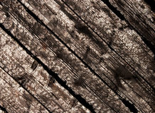 Burnt wood planks in sunlight Stock Images