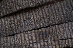 Burnt wood wall. Royalty Free Stock Image