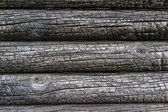 Burnt wooden house wall Royalty Free Stock Image