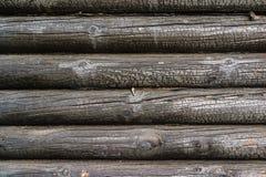Burnt wooden house wall Stock Photos
