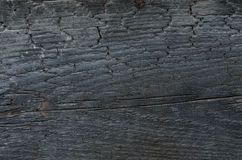 Burnt wooden wall background texture Stock Photo