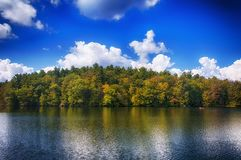 Burr Pond State Park in Autumn. The colorful trees of Autumn reflecting off of the waters in Burr State Park in Torrington, Connecticut on a sunny fall day stock photo