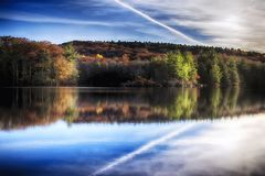Burr Pond State Park autumn landscape. Reflections of the colorful fall foliage on the water at Burr Pond Torrington, Connecticut during autumn stock images