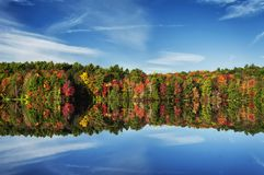 Burr Pond State Park Autumn New England. The colorful trees of Autumn reflecting off of the waters in Burr State Park in Torrington, Connecticut on a sunny fall stock images