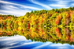 Burr Pond State Park Autumn New England. The colorful trees of Autumn reflecting off of the waters in Burr State Park in Torrington, Connecticut on a sunny fall stock photo