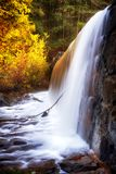 Burr Pond State Park autumn waterfall. A blurred waterfall background and flowing stream nature picture at Burr Pond Torrington, Connecticut stock image