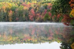 Burr Pond State Park. Fall foliage reflecting off of the misty waters of Burr Pond State Park in Torrington Connecticut in Autumn Stock Photos